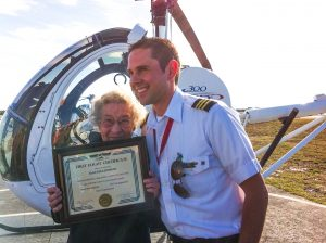 with helecopter pilot and certificate